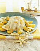 Rice pudding with bananas and apricots for children