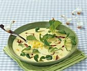 Creamed corn soup with bacon and corn salad for children