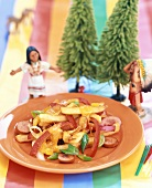 Sausage slices with peppers, chips and cheese for children