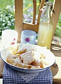 Fried pastries with apricot filling & icing sugar (S. Tyrol)