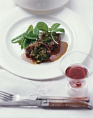 Braised veal cheeks with herbs and mangetout