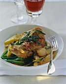 Rabbit legs with green beans and pears