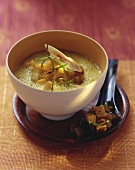 Polenta & lemon grass soup with mango and chilli croutons