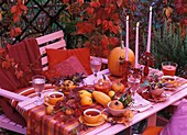 Tea table with autumn decorations in the open air