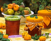 Quince jelly in jars on a table in the open air