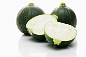 Three round courgettes, one halved