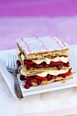 Cream slice with strawberries and redcurrants