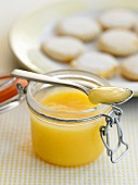 Lemon curd in jar and on spoon
