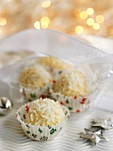 White chocolate truffles with grated coconut for Christmas
