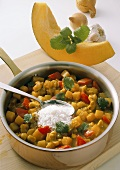 Pumpkin and potato curry with grated coconut