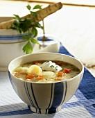 Parsnip soup with tomatoes and crème fraîche