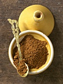 Baharat spice in yellow bowl (overhead view)