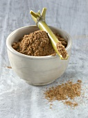 Five spice powder in bowl with bamboo cane