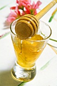 Honey in glass with honey dipper