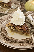 Slice of pecan pie with cream for Thanksgiving (USA)