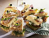 Savoury sandwich cake with salmon, soft cheese & rocket filling