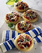 Mini-pizzas with salami