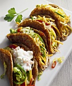 Tacos with vegetable filling and yoghurt sauce
