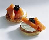 Blinis topped with smoked salmon and caviar