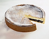 Pear and poppy seed cheesecake, a slice taken