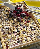 Berry crumble cake on baking tray