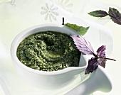 Pesto alla genovese (Basil pesto in mortar, Italy)