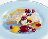 Tea parfait with fruit sauces and raspberries