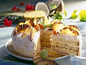 Coconut and pineapple cake, a piece cut