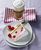 A piece of raspberry yoghurt cake with coffee