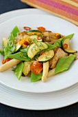 Mixed vegetable salad with chicken and edible flowers