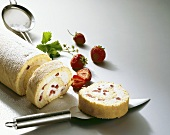 Strawberry and cream roulade, partly sliced