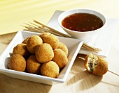 Deep-fried cheese balls with chilli sauce