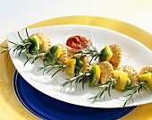 Small mascarpone pasties with peppers on rosemary skewers