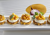 Corn cakes with cheese creme and mango salsa
