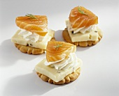 Crackers topped with cheese and salmon