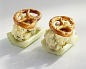 Celery boats with cheese and salted pretzels