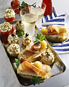 Assorted appetisers and open sandwiches on tray