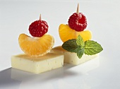 Cheese and fruit on two cocktail sticks