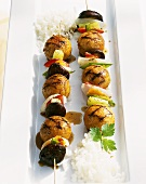 Grilled fish balls and vegetables on skewers
