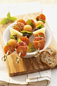 Tomatoes, cheese, sausage and melon on skewers