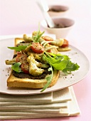 Olive paste, vegetables and rocket on toast