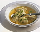 Broth with filled pasta squares
