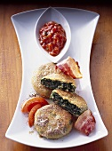 Kale cakes with bacon and spicy tomato sauce