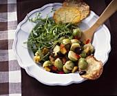 Brussels sprout & pumpkin salad with rocket & potato crisps