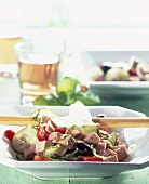 Sausage, olive, cucumber and tomato salad (Italy)