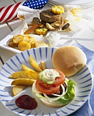Hamburger with potato wedges, fillet steak with sweetcorn (USA)