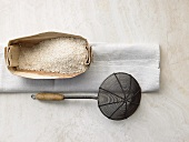 Rice in woodchip basket, straining spoon
