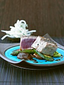 Tuna steak on teriyaki vegetables
