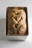Chestnut and apricot bread in baking tin