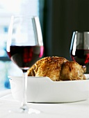 Roast chicken and two glasses of red wine
